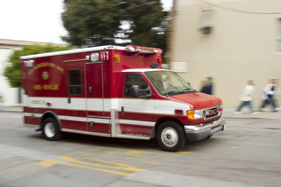 An ambulance speeding down a street to tend to a premises liability victim.