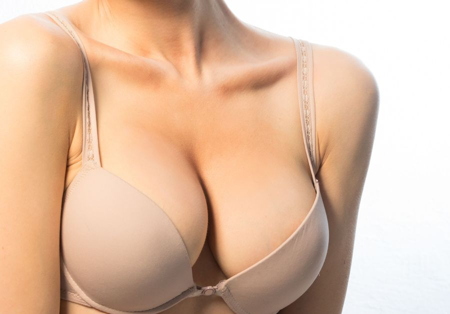 Close-up of a voluptuous bust in a beige bra