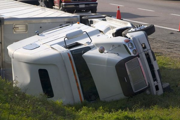 Semi truck lying on its side