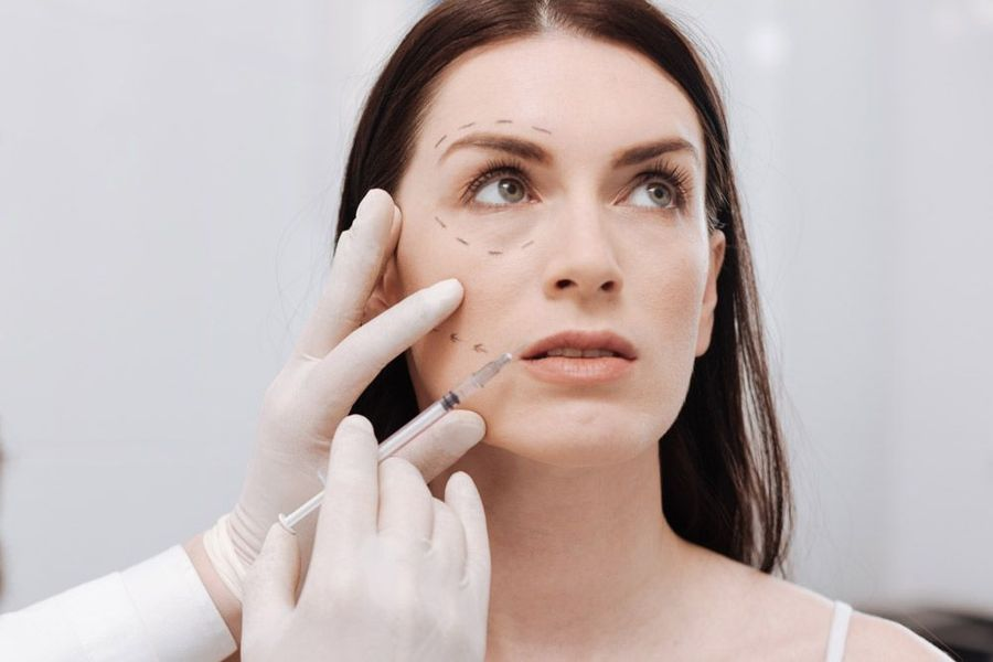 Female patient undergoing a consultation exam to establish her dermal filler treatment plan.