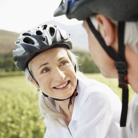 Photo of older couple in bike helmets