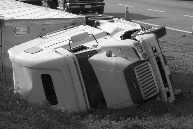 Photo of an overturned semi truck