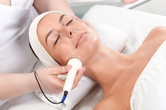 Woman undergoing dermabrasion treatment