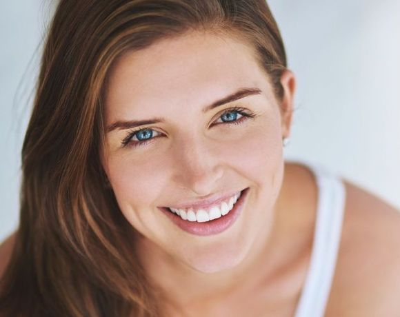Close-up image of a woman's beautiful smile
