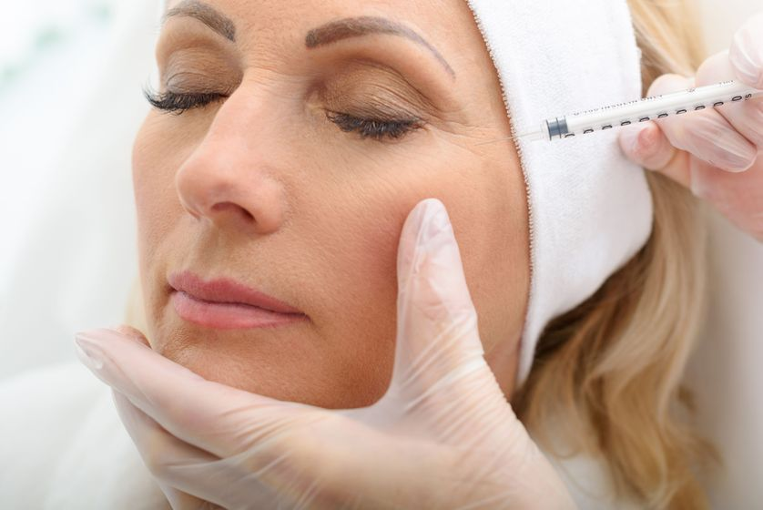 Woman receiving Botox cosmetic injection