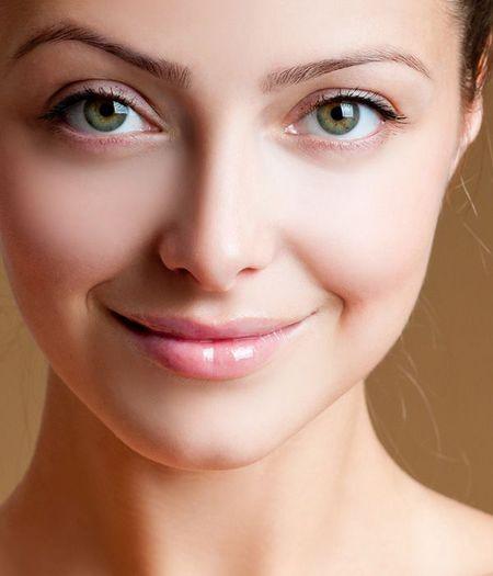 A closeup of a woman's cheekbones