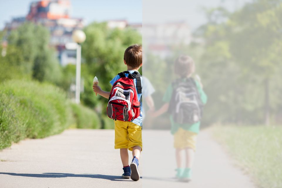 Children walking down the street, blurred vision on half of image.