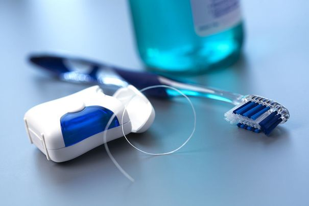 image of toothbrush and dental floss