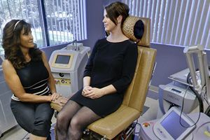 Photo of esthetician consulting with a patient