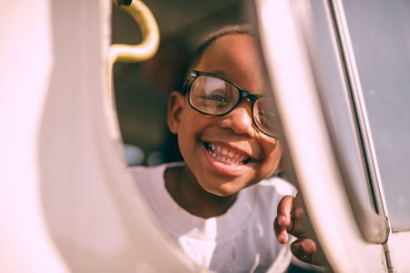 Smiling boy in glasses