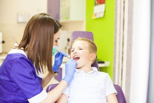 A young boy undergoing a dental exam