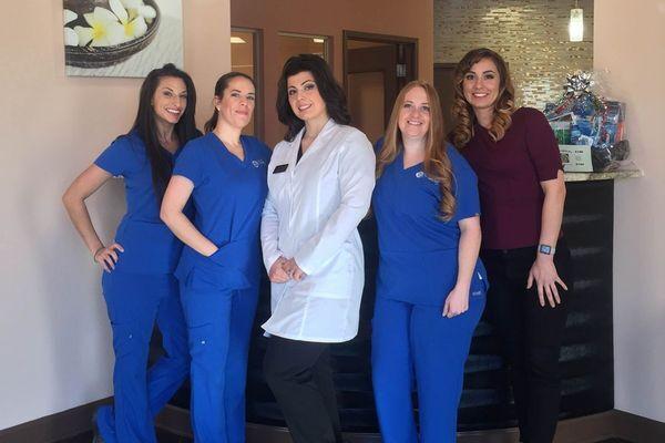 Group photo of Dr. Gjelaj and dental staff