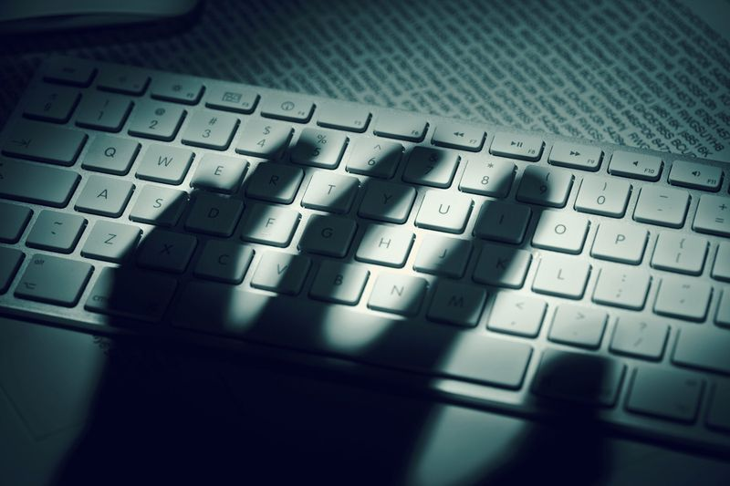 Photo of a hand shadow over a keyboard