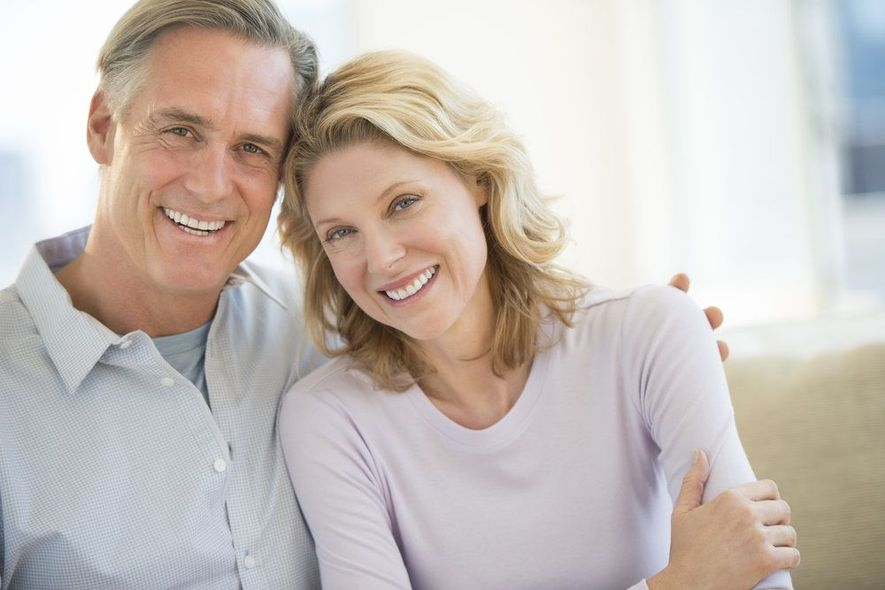 man and woman smiling after dental visit