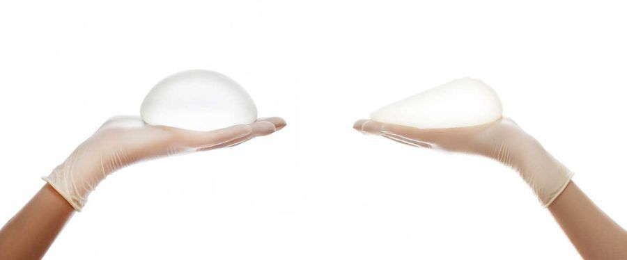 Breast implants in gloved hands