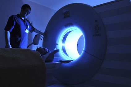 A patient entering an MRI machine