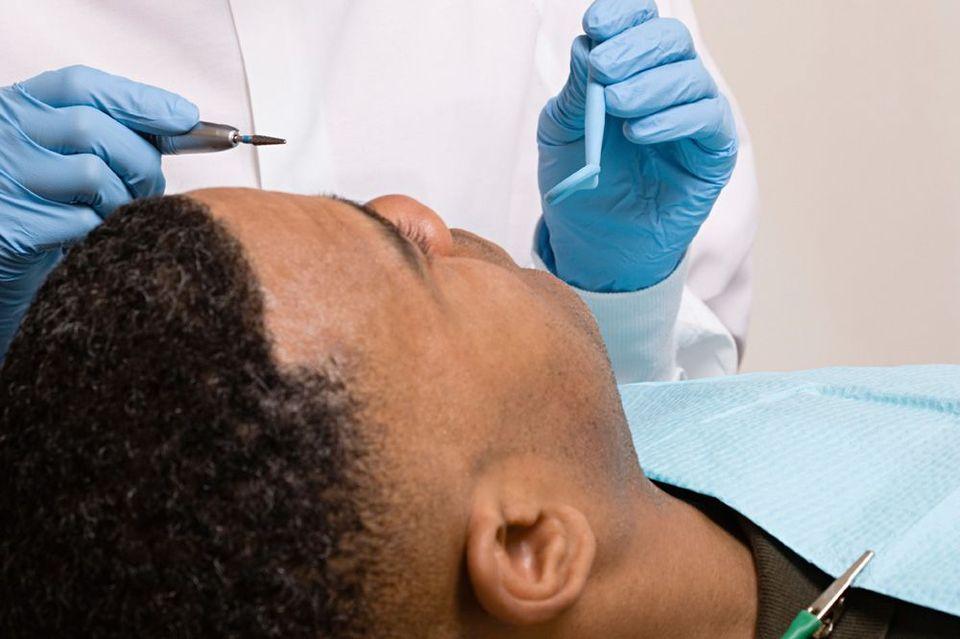 Patient undergoing a dental procedure.