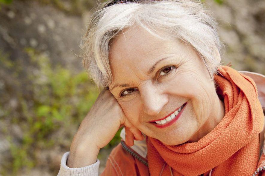 An older lady displays her custom dentures