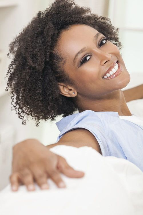 A smiling, relaxed woman