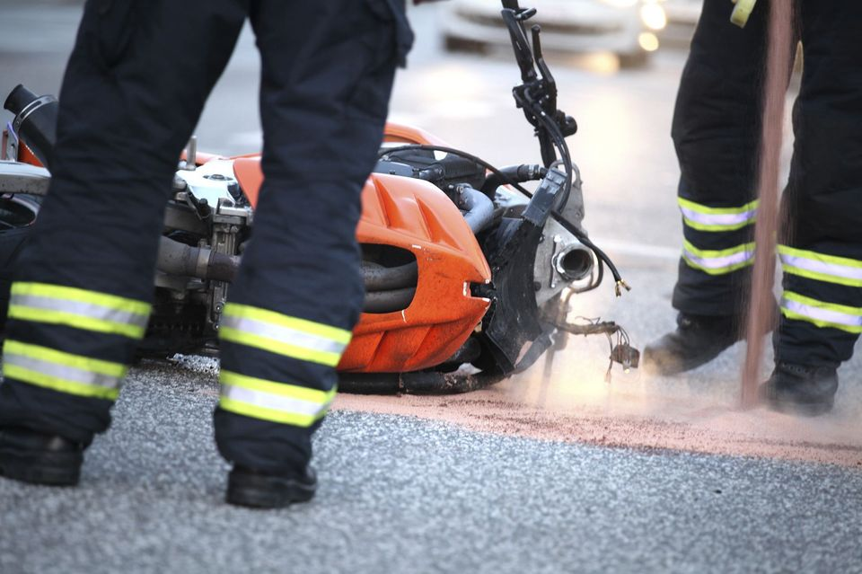 A motorcycle on the ground after an accident.
