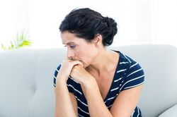 A woman looking anxious and stressed