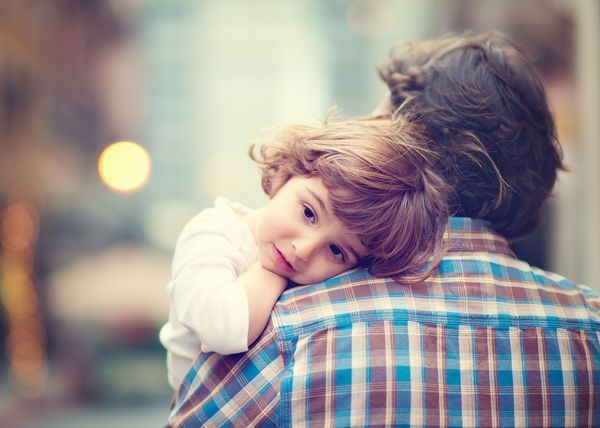 A girl with her father.
