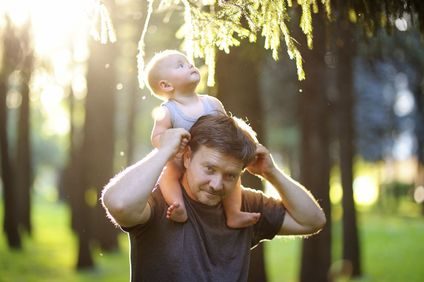 Photo of a man with child on his shoulders