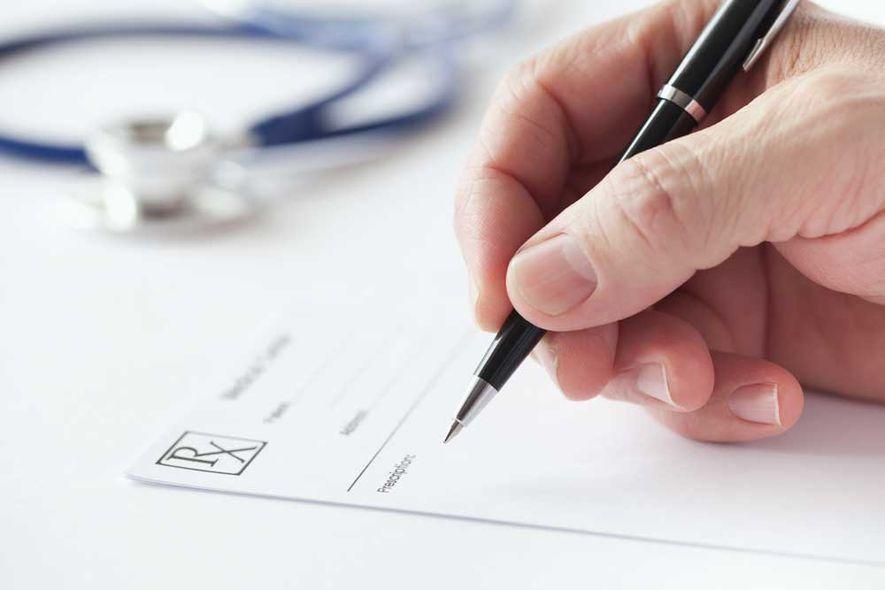 image of signing medical form