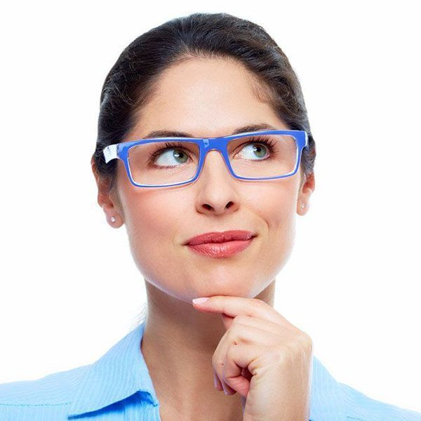 Woman wearing blue glasses with hand on chin