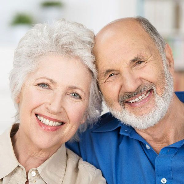 Couple smiling after having received inlays