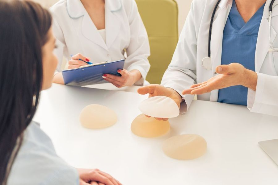 A physician discussing breast implant types with a patient.
