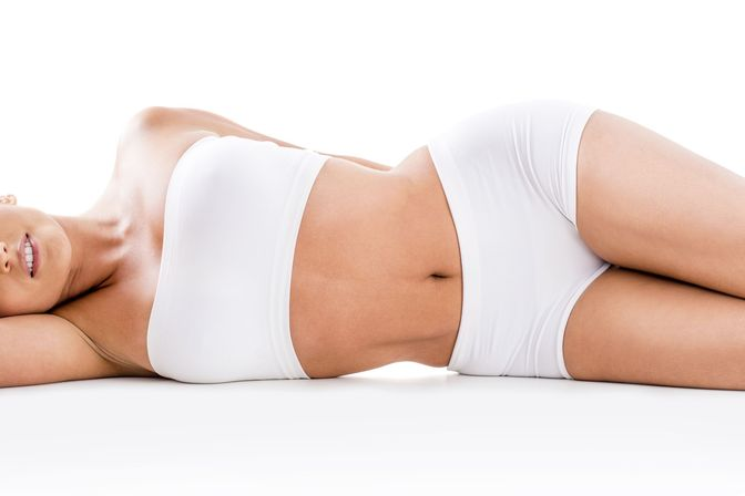 Slim woman lying on her side