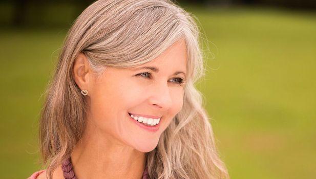 white woman smiling teeth gray hair
