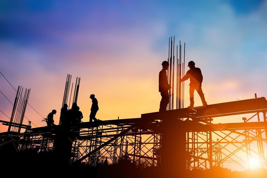 Photo of construction workers on scaffolding