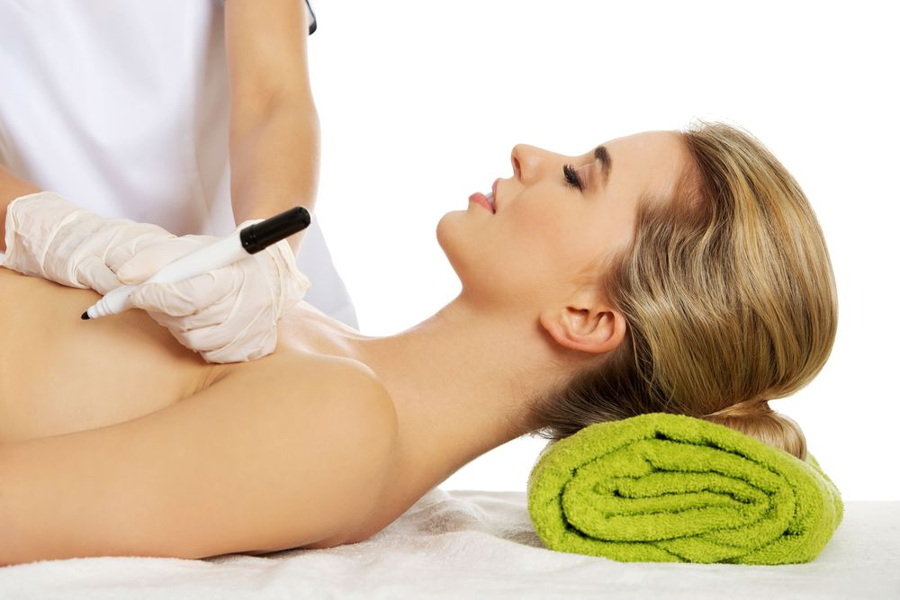 A woman is examined for breast reconstruction surgery.