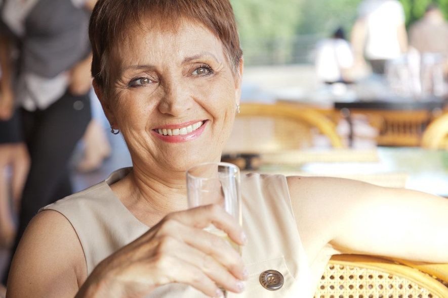 Smiling senior woman at a cafe