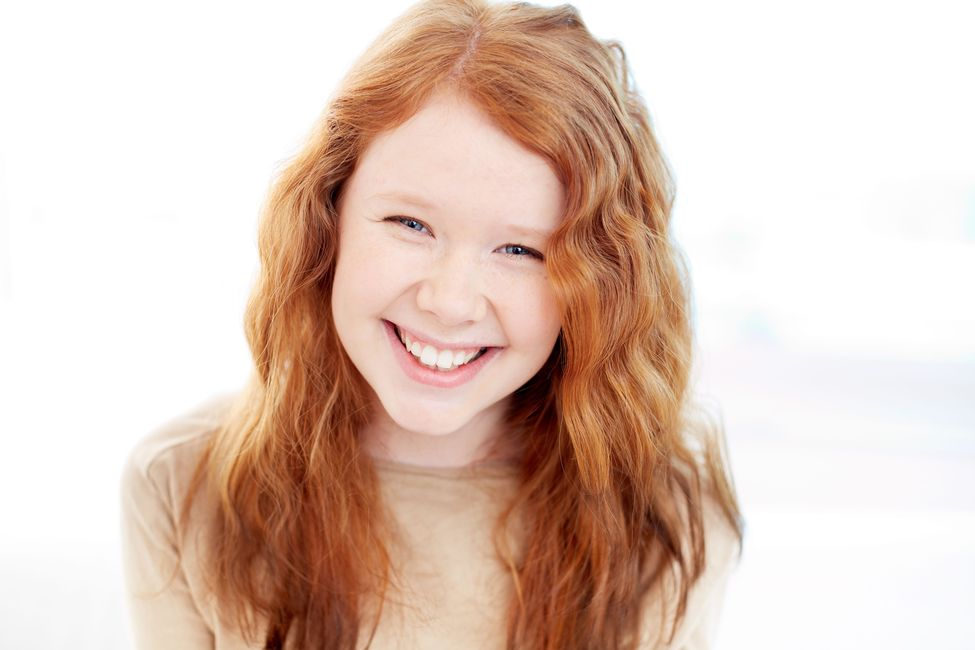 Young girl with red hair.