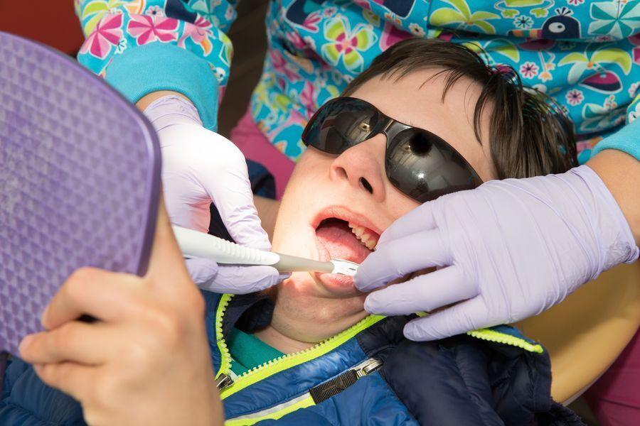 Child undergoing a dental exam