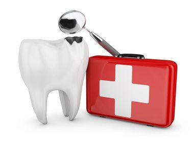 Damaged tooth, dental exam mirror, and first aid kit