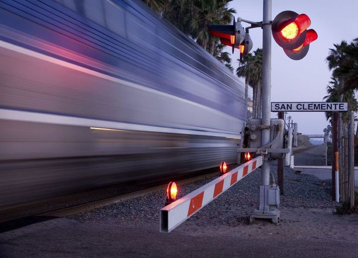A train going through a railroad crossing