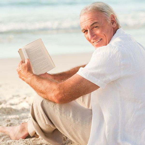 Older man sitting on beach