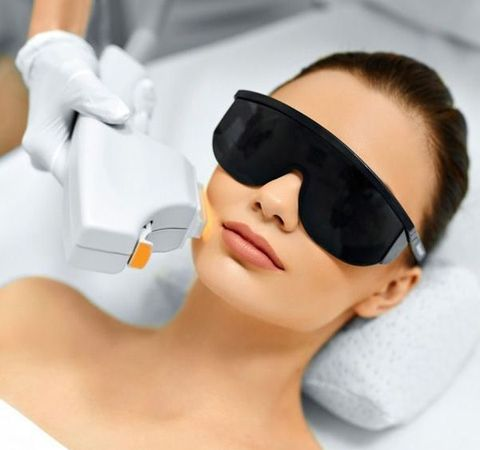 Woman undergoing laser treatment