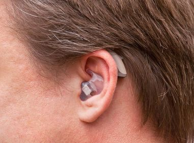 Close up of man's hearing aid