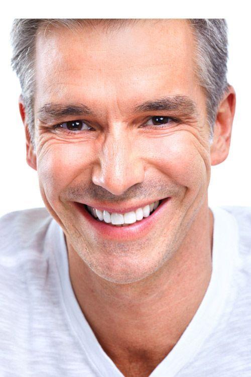 A man smiles broadly