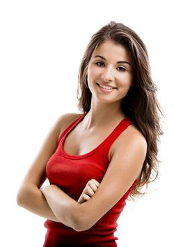 Young brunette woman smiling with her arms folded