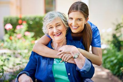Photo of young woman hugging older woman from behind
