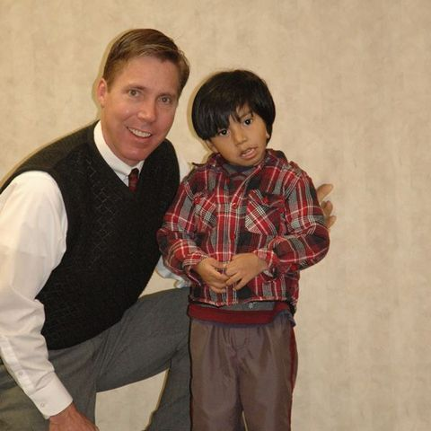 Dr. Griffiths posing for a picture with a boy
