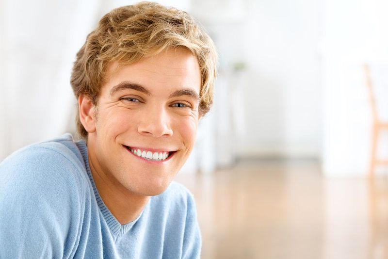 A young man with an attractive smile