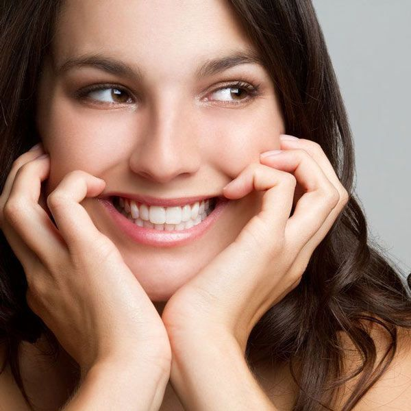 Woman smiling after having received a dental filling