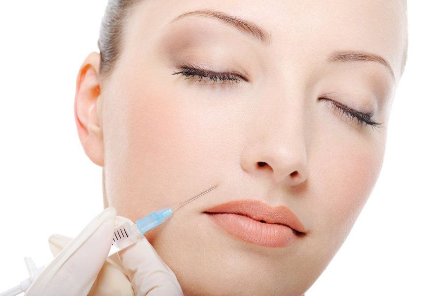 Photo of a woman receiving BOTOX cosmetic